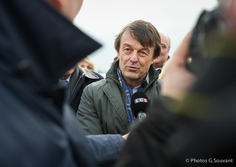 FRANCE, Juille : French Minister for the Ecological and Inclusive Transition Nicolas Hulot looks on a wind turbine on January 08, 2018 in Juille, western France. PHOTO / GUILLAUME SOUVANT/SIPA